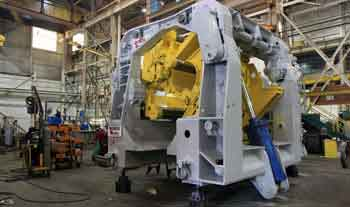 downcoiler for rolling mills